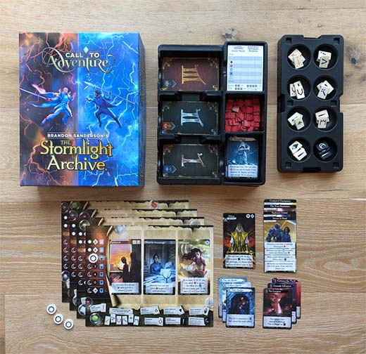 Componentes del juego de mesa Call to Adventure: The Stormlight Archive